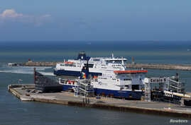 FILE - Cross-Channel ferries are seen in the port of Calais, France, June 24, 2016.