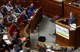 FILE - Ukrainian President Petro Poroshenko addresses parliament during the opening ceremony parliamentary session in Kiyv, Ukraine, Tuesday, Sept. 6, 2016.