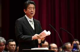 Japan's Prime Minister Shinzo Abe delivers a speech during the graduation ceremony of the National Defense Academy in Yokosuka, Kanagawa prefecture, Japan, March 18, 2018.