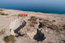 FILE - An aerial view shows sinkholes in the abandoned tourist resort of Ein Gedi on the Dead Sea shore, Nov. 28, 2017. Israel is heading into its fifth consecutive year of drought, putting three celebrated biblical bodies of water at risk.