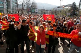 People protest in front of the EU office in Skopje, Macedonia, March 21, 2017.