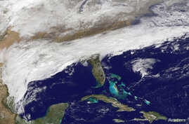Clouds can be seen associated with a major winter storm that is bringing wintry precipitation and chilly temperatures to the U.S. South, Feb. 11, 2014.