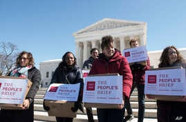 """Members of the Human Rights Campaign deliver """"People's Brief"""" with more than 200,000 signatures in support of marriage equality to the Supreme Court in Washington, March 6, 2015."""