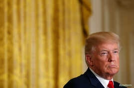U.S. President Donald Trump listens during his joint news conference with Finnish President Sauli Niinisto at the White House in Washington, Aug. 28, 2017.