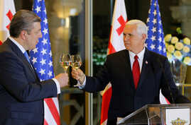 U.S. Vice President Mike Pence toasts with Georgian Prime Minister Georgy Kvirikashvili during an official dinner in Tbilisi, Georgia, July 31, 2017.