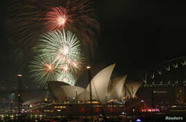 Fireworks explode over the Sydney Opera House in a 9pm display before the midnight fireworks which will usher in the new year in Australia's largest city, Dec. 31, 2015.