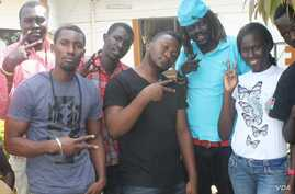 Musicians from South Sudan and Uganda, including Michael Ross (2nd from left), Meem Mabior Maen (3rd from right), and Joan Atieno (2nd from right) collaborated on a song for peace in South Sudan.
