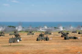 Taiwan's military fire artillery from M110A2 self-propelled Howitzers during the annual Han Kuang exercises in Hsinchu, north eastern Taiwan, Thursday, Sept. 10, 2015.