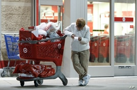 Betsy McGonagle checks her receipt after shopping for Black Friday discounts at a Target store, Philadelphia, Pennsylvania, November 23, 2012.