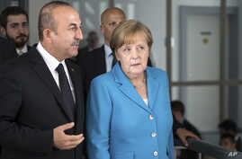 Turkish Foreign Minister Mevlut Cavusoglu talks with German Chancellor Angela Merkel in Duesseldorf, western Germany, May 29, 2018.