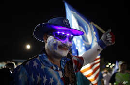 A pro-statehood New Progressive Party supporter waves his party's flag during their closing campaign rally in San Juan, Puerto Rico, November 3, 2012.