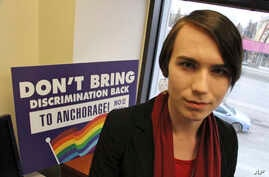 In this photo taken Monday, April 9, 2018, Lillian Lennon poses for a photo in Anchorage, Alaska. Lennon, a transgender teenager, was a field organizer who helped defeat a bathroom bill before Anchorage voters this month.