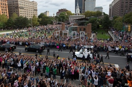 Pope Francis passes the crowd in his pope mobile on Independence Mall in Philadelphia, Sept. 26, 2015. The pope spoke at Independence Hall on his first visit to the United States.