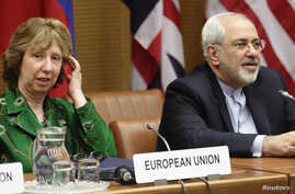FILE: European Union foreign policy chief Catherine Ashton, left, and Iranian Foreign Minister Mohammad Javad Zarif smile at the start of nuclear talks in Vienna April 8, 2014.