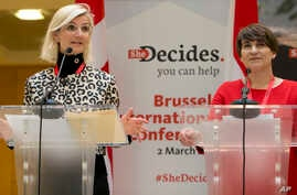 Dutch Minister for Trade and Development Cooperation Lilianne Plouman (right) and Danish Minister for Development and Cooperation Ulla Toernaes address a media conference, She Decides, at the Egmont Palace in Brussels,  March 2, 2017. Nations are ple