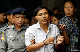 Detained Reuters journalist Kyaw Soe Oo leaves after a court hearing in Yangon, Myanmar, June 5, 2018.