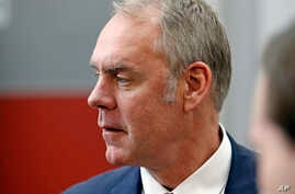 U.S. Interior Secretary Ryan Zinke walks through the Western Conservation and Hunting Expo, Feb. 9, 2018, in Salt Lake City.