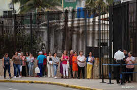 People wait in line to enter the U.S. embassy in Havana, Cuba, March 18, 2019.