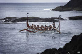Aboriginal men of the Tao tribe take a newly launched fishing boat on a maiden voyage during a fishing boat launching ceremony on Orchid Island, Taiwan.