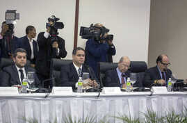 (L-R) Representatives of the Venezuelan opposition Eudoro Gonzalez, Luis Florido, Vicente Diaz and Julio Borges are pictured during their meeting with Venezuelan government's representatives at the Dominican Ministry of Foreign Affairs in Santo Domin