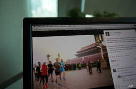 A computer screen displays the social media posting by Mark Zuckerberg on Facebook in Beijing, China, Friday, March 18, 2016. The photo of Facebook founder Mark Zuckerberg jogging in downtown Beijing's notorious smog has prompted a torrent of astonis