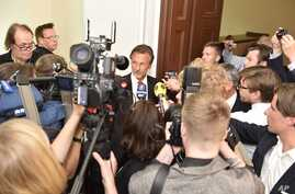 Julian Assange's lawyer Tomas Olsson, center, talks to media prior to a public court hearing in Stockholm, Sweden, July 16, 2014.