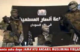 FILE - An image grabbed on December 24, 2012 a video released by Jama'atu Ansarul Muslimina fi Biladis Sudan, the radical Islamist group known as Ansaru, reportedly shows unidentified members of the group speaking in an undisclosed place in November