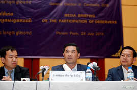 Kem Reat Viseth (C), head of the government committee in charge of election monitoring, speaks during a media briefing on the participation of observers, in Phnom Penh, Cambodia, July 24, 2018.