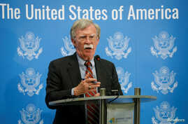 U.S. President Donald Trump's national security adviser, John Bolton, speaks at a news conference in Kyiv, Ukraine,  Aug. 24, 2018.