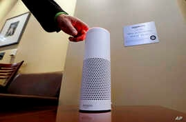 FILE - An Amazon Alexa device is switched on for a demonstration of its use in a ballpark suite before a Seattle Mariners baseball game in Seattle, WA., May 17, 2017.