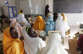 Children displaced by Boko Haram during an attack on their villages receive lectures in a camp in Maiduguri, Nigeria, Dec. 7, 2015.
