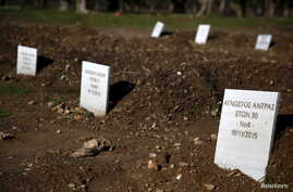 Tombstones are placed on graves of unidentified refugees and migrants who drowned at sea during an attempt to cross a part of the Aegean Sea from the Turkish coast, at a cemetery near the village Kato Tritos on the Greek island of Lesbos, Feb. 6, 201