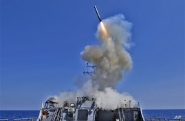 The Arleigh Burke-class guided-missile destroyer USS Barry launches a Tomahawk cruise missile from the ships bow, off the Libyan coast, March 2011. (file)