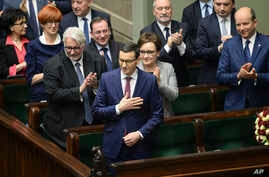 New Polish Prime Minister Mateusz Morawiecki (C) thanks lawmakers for applause after giving his policy speech in the parliament in Warsaw, Poland, Dec. 12, 2017.