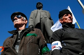 Activists stand guard during a pro Russian rally at a central square in Donetsk, eastern Ukraine, March 23, 2014.