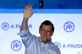 Spain's acting Primer Minister and candidate of Popular Party Mariano Rajoy, waves to his supporters as he celebrates the results of the party during the national elections in Madrid, Spain, Sunday, June 26, 2016.