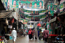A street is decorated with the flags and banners of political parties ahead of a general election in Rawalpindi, Pakistan, July 23, 2018.