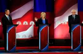 Democratic presidential candidate, Hillary Clinton, center, speaks at the NBC, YouTube Democratic debate at the Gaillard Center, Jan. 17, 2016, in Charleston, South Carolina. To the left is former Maryland Gov. Martin O'Malley and, to the right, Sena
