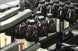Honest Tea bottles get packaged for distribution and eventual consumer sale