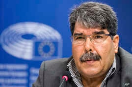 Then co-chair of the Syrian Kurdish Democratic Union Party (PYD) Salih Muslim addresses journalists at the European Parliament in Brussels, Belgium, Sept. 1, 2016.