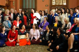 A group of New Zealand women lawmakers featuring Prime Minister Jacinda Ardern in the center holding baby Neve pose for a photograph at Parliament, Sept. 19, 2018, in Wellington, New Zealand.