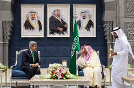 U.S. Secretary of State John Kerry, left, attends a coffee ceremony with Saudi Foreign Minister Prince Saud al-Faisal as a welcome upon Kerry's arrival in Jeddah, Saudi Arabia, June 25, 2013.