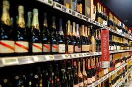 FILE - Bottles of Champagne are displayed for sale in a supermarket in Vertou, near Nantes, France, June 20, 2017.