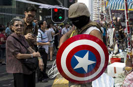 A protester of the Occupy Central movement carries a 'Captain America' shield at the Mong Kok shopping district in Hong Kong, Oct. 6, 2014.