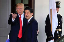 President Donald Trump welcomes Japanese Prime Minister Shinzo Abe to the White House in Washington, June 7, 2018.