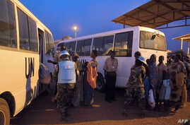 Civilians seeking shelter are seen at the local U.N. Mission compound near Juba airport on December 17, 2013.