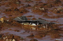 FILE - Debris of a house is pictured at Bento Rodrigues district, which was covered with mud after a dam owned by Vale SA and BHP Billiton Ltd. burst in Mariana, Brazil, Nov. 6, 2015.