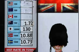 A currency exchange board with washed out rates is seen in London, Oct. 12, 2016.