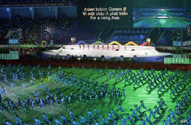 FILE - Martial arts performers are seen during the opening ceremony of the Third Asian Indoor Games at My Dinh National Stadium in Hanoi, Vietnam, Oct. 30, 2009.