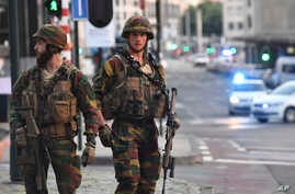 Belgian Army soldiers patrol outside Central Station after a reported explosion in Brussels, June 20, 2017.